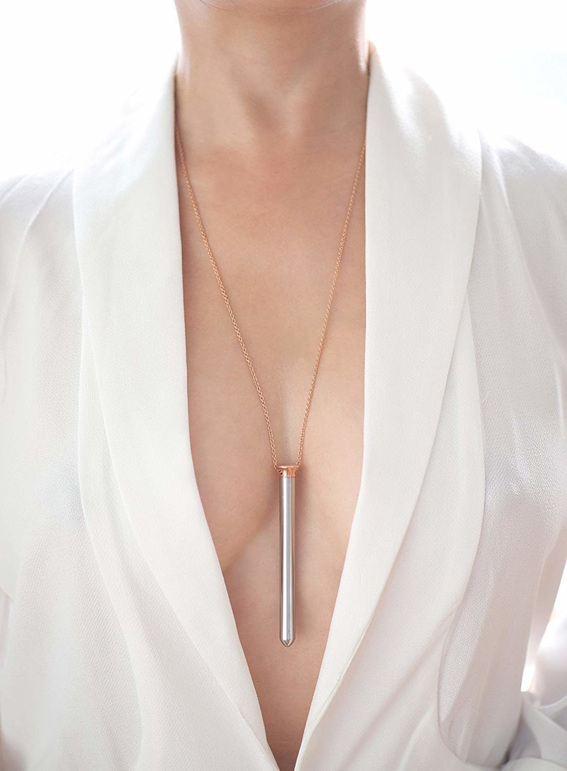 model wears a thin long silver vibe on rose gold chain