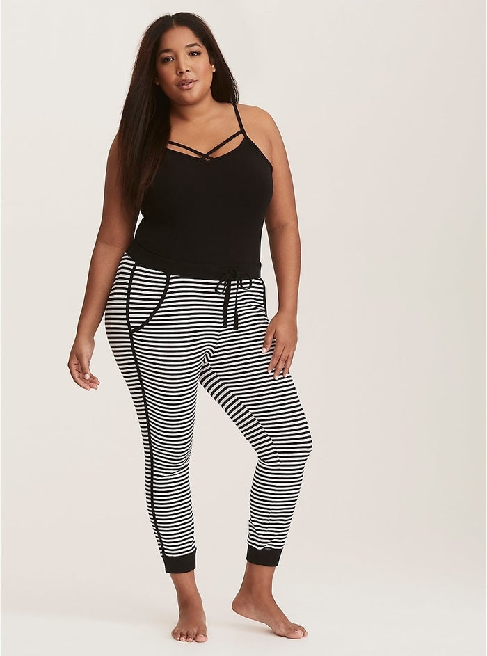 "Comfy factor: ""I bought these about a month ago, and I'm so glad I did! So comfy and cozy! The waist band is comfortable and nice and wide, they're like leggings' + pajama pants' perfect love child! 110% recommend!"" —TayvandyGet them from Torrid for $29.98 (originally $36.90; available in sizes M–6X)."