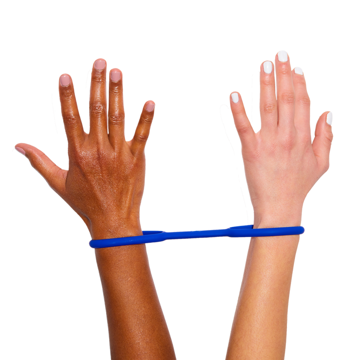 two hands connected with the handcuffs