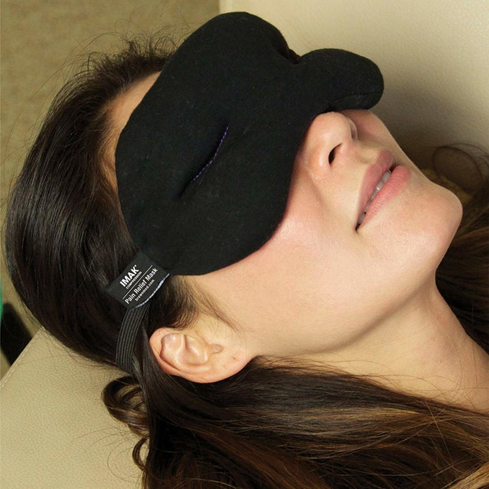 """Promising review: """"This mask is simply amazing. I mainly use it to block out the light when I have a migraine and it does a great job. The little beads inside allow it to contour to your face and add the smallest bit of weight to relieve eye pressure from a headache. The only downfall I have found is with the single strap. It's adjustable, which is great, but it's a single strap which can make placement tricky if I am wearing my hair up and doesn't stay in place while I'm sleeping. Could definitely benefit from a double strap. I haven't stuck it in the freezer for fear of the soft cloth soaking up weird smells, and if you've had a migraine, you know how smells can affect you during a headache! However, aside from not getting to experience the full cooling action of this mask, the beads stay cool on their own and I am always pleasantly surprised how cool they are when I put the mask on. I may have to buy another because my husband enjoys the feel of this mask, too. Definitely, a great purchase if you suffer from any type of headaches."""" —Christie L. BowmanGet it from Amazon for $13.12."""