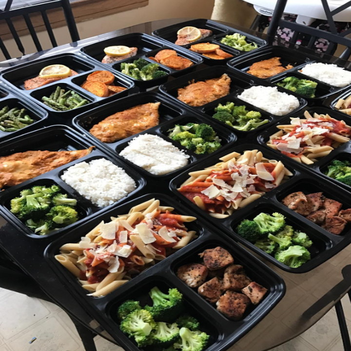 Reviewer meal prep containers with food in them