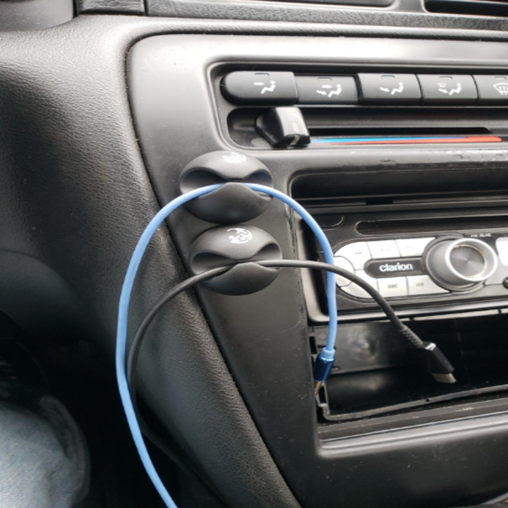 Reviewer cable clips in use in car