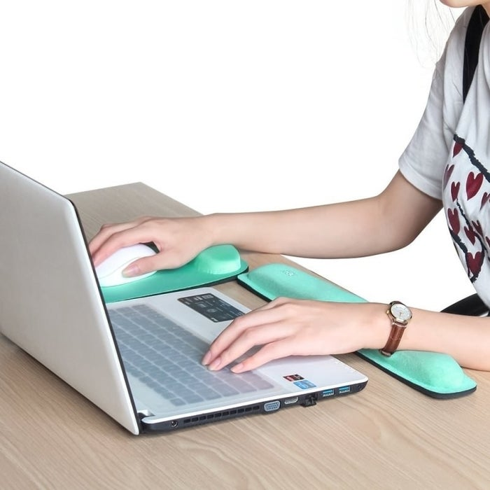 """Promising review: """"This worked out very well for me. I have tendinitis in my wrist and thumb joint. This mouse pad has given my wrist the right amount of support I need and is still comfortable to use with a mouse. I like that the pad is longer than many other memory-foam mouse pads as I move my hand around a lot."""" —Amazon CustomerGet it from Amazon for $16.96 (available in mint and black)."""