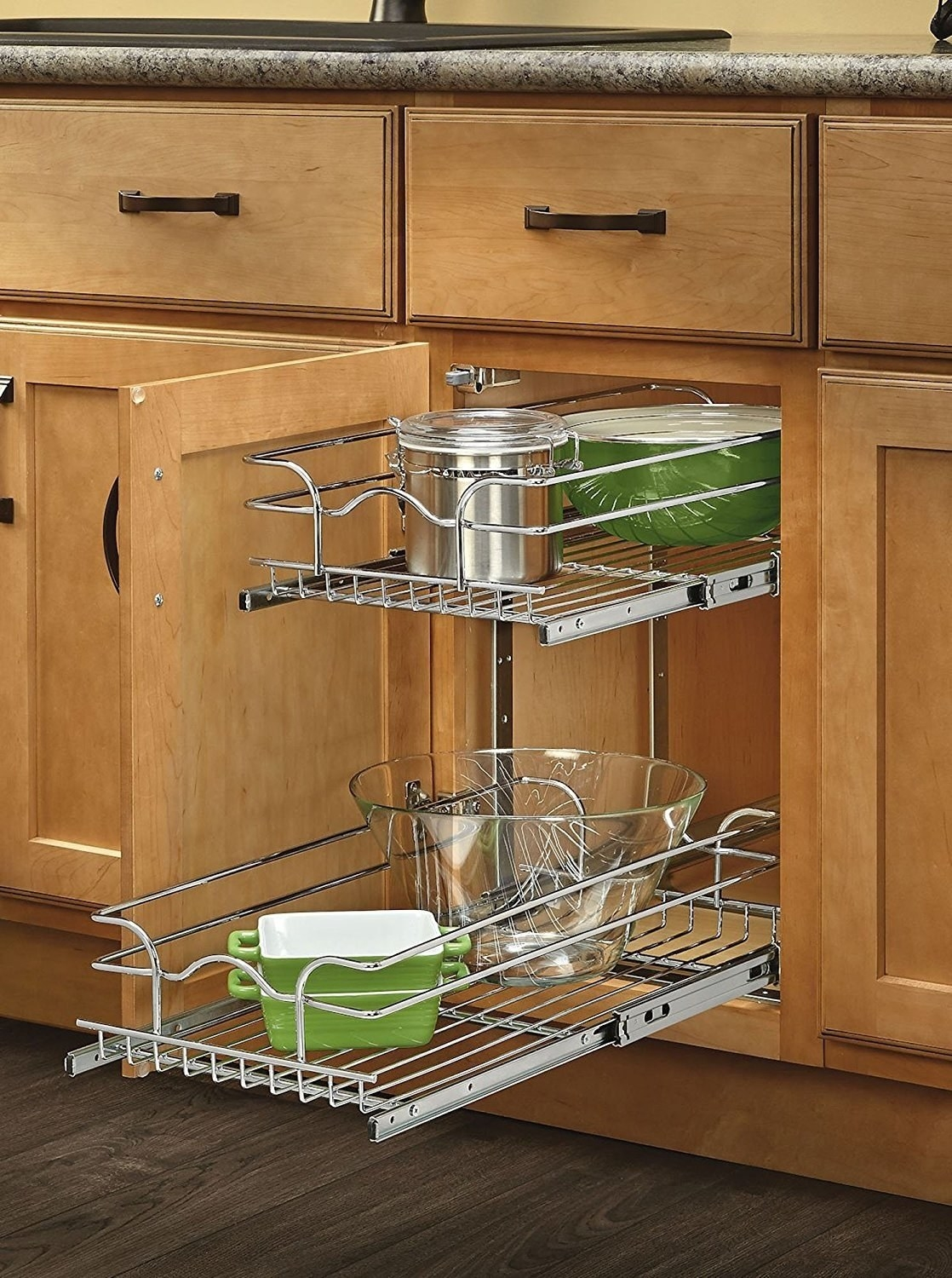 A cabinet system installed with two wire drawers that pull out for easy access to bowls and other kitchen items