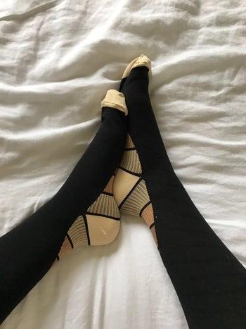 someone wearing the black and beige socks