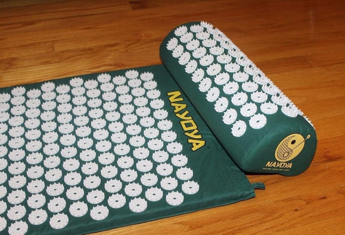 "Check out a BuzzFeeder's full review of this acupressure mat, and if you want a full rundown on how to use it, we've got you covered there too. Promising review: ""Whenever my back aches, I just lay on this acupressure mat and it goes away. The first time I used it I had a hard time staying still. My back felt so itchy I had to keep moving to break the connection between spikes and skin. I've since found out that it meant I had a lot of tension for the mat to release and that it was working. Each time I laid on it, that sensation was less and less. It wasn't long before I was dozing off as I laid on it. You have to be very careful though, the spikes are SHARP. The first time I laid on it, I tried to reposition and my arm rubbed against the spikes, drawing blood and leaving a scrape that looked like road rash. You have to make sure you always move upward off the spikes and not across them. I've laid on the mat with bare skin and the spikes do NOT break the skin when you're laying on it."" —AmyGet it from Amazon for $39.97."