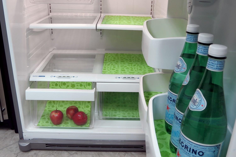 the shelf liners in green in a fridge, on inner shelves, doors shelves, and in drawers