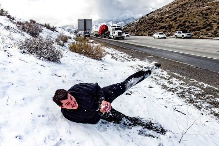 Martin Dominguez plays in the snow on side of the I-15 in the Cajon Pass near Phelan, California.