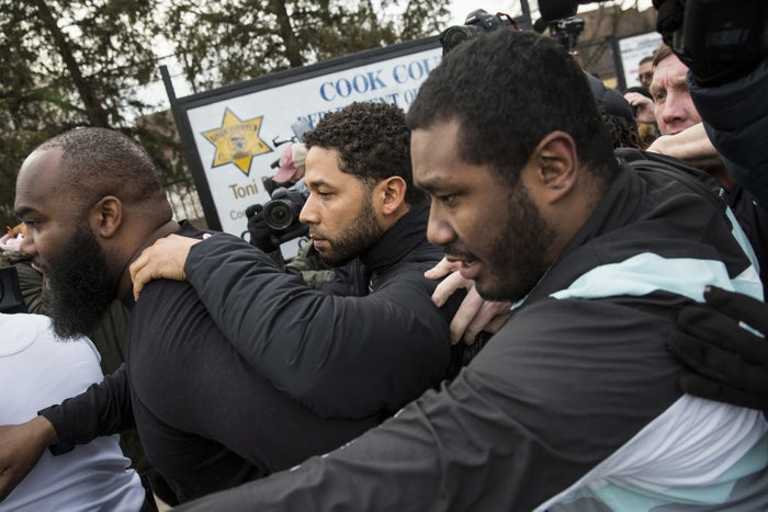 Jussie Smollett, center, leaves Cook County jail following his release, on Feb. 21, 2019, in Chicago.