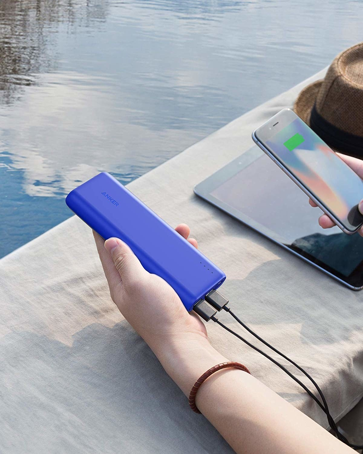 a hand holding the blue portable charger