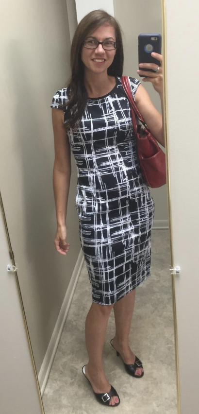 974742b8a8f3 A printed office sheath dress that'll stand out at work with eye-catching  appeal.