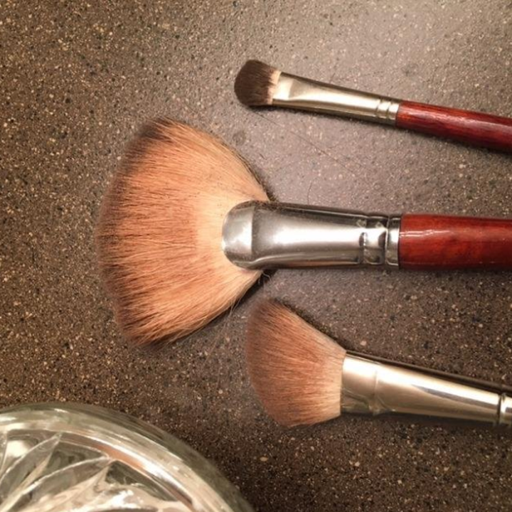 Reviewer brushes before using cleaner