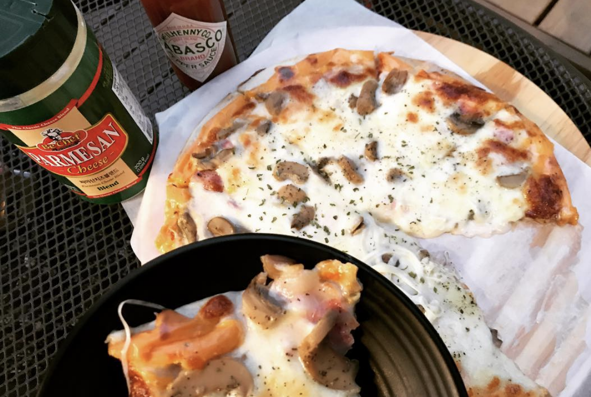 "My absolute favourite ""weird"" food combo is cream cheese on pizza. Like, you have the regular mozzarella and whatnot, it's just that you then spread on a layer of cream cheese. It's really popular in my home state and also I'm told in Nebraska, but it's so hard to find elsewhere.—fredzesty"