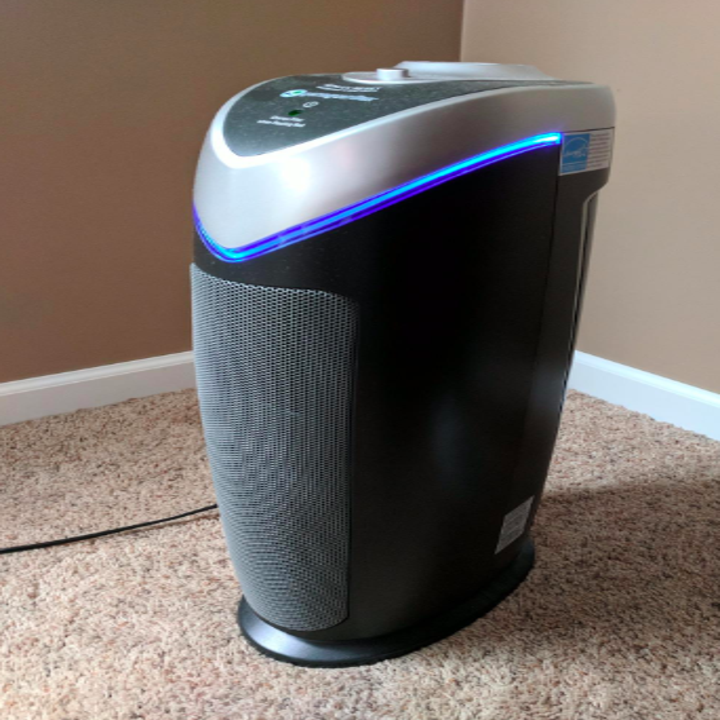 The black standing air purifier in a reviewer's home