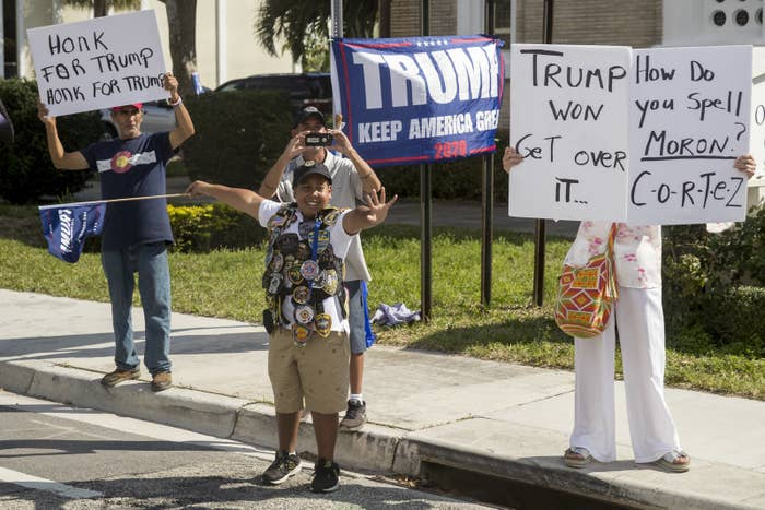 Supporters greet President Donald Trump's motorcade in West Palm Beach, Florida, Feb. 17, 2019.