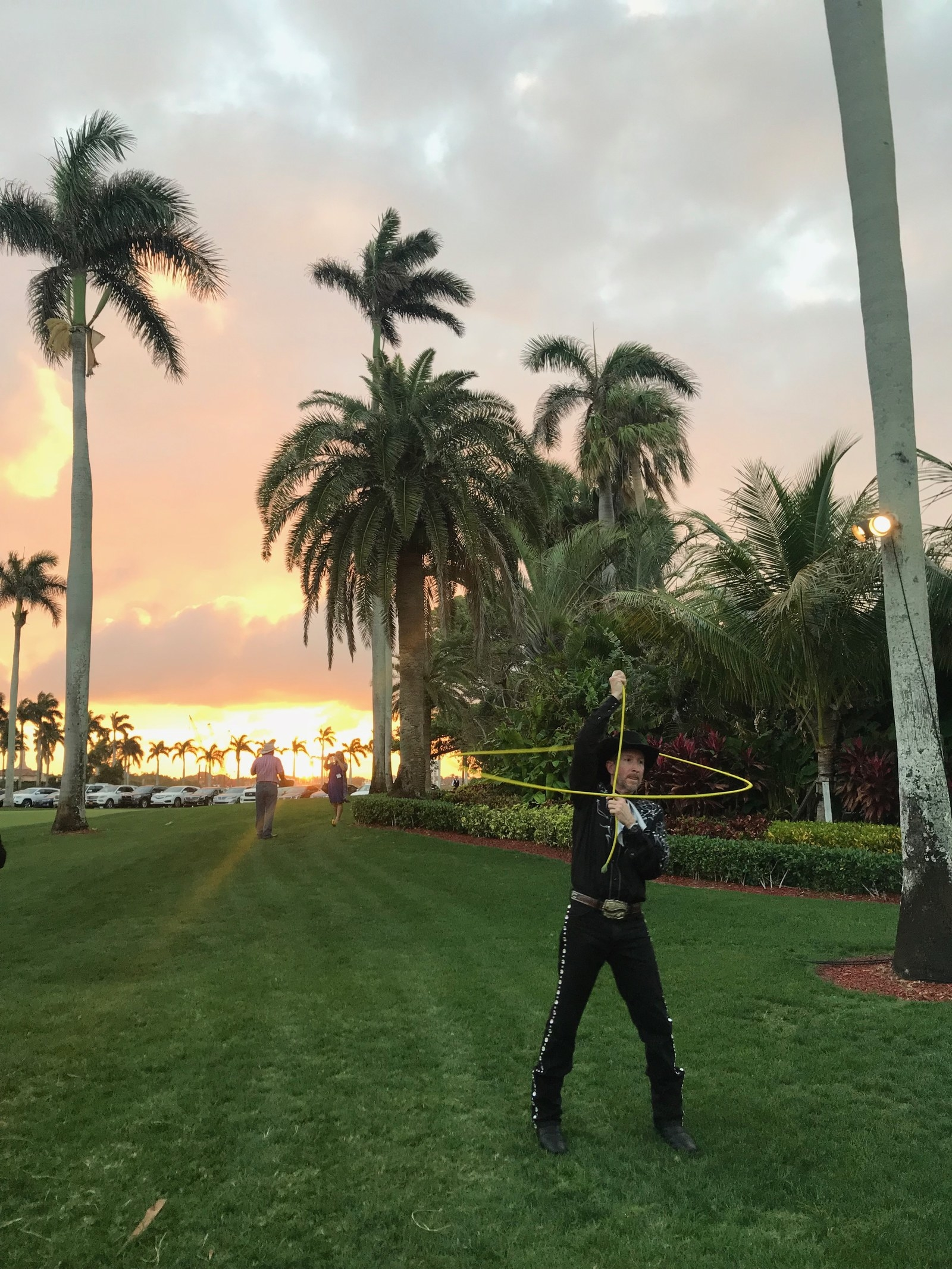 A man performing cowboy tricks at the Mar-a-Lago party, Feb. 23.