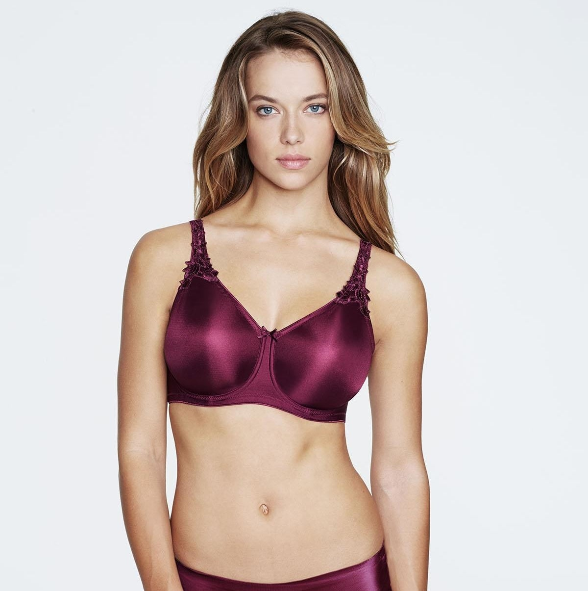 Model wearing the bra with floral straps in magenta