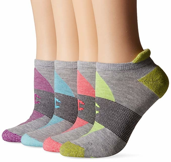 four feet showcasing the grey socks with different color ways on each