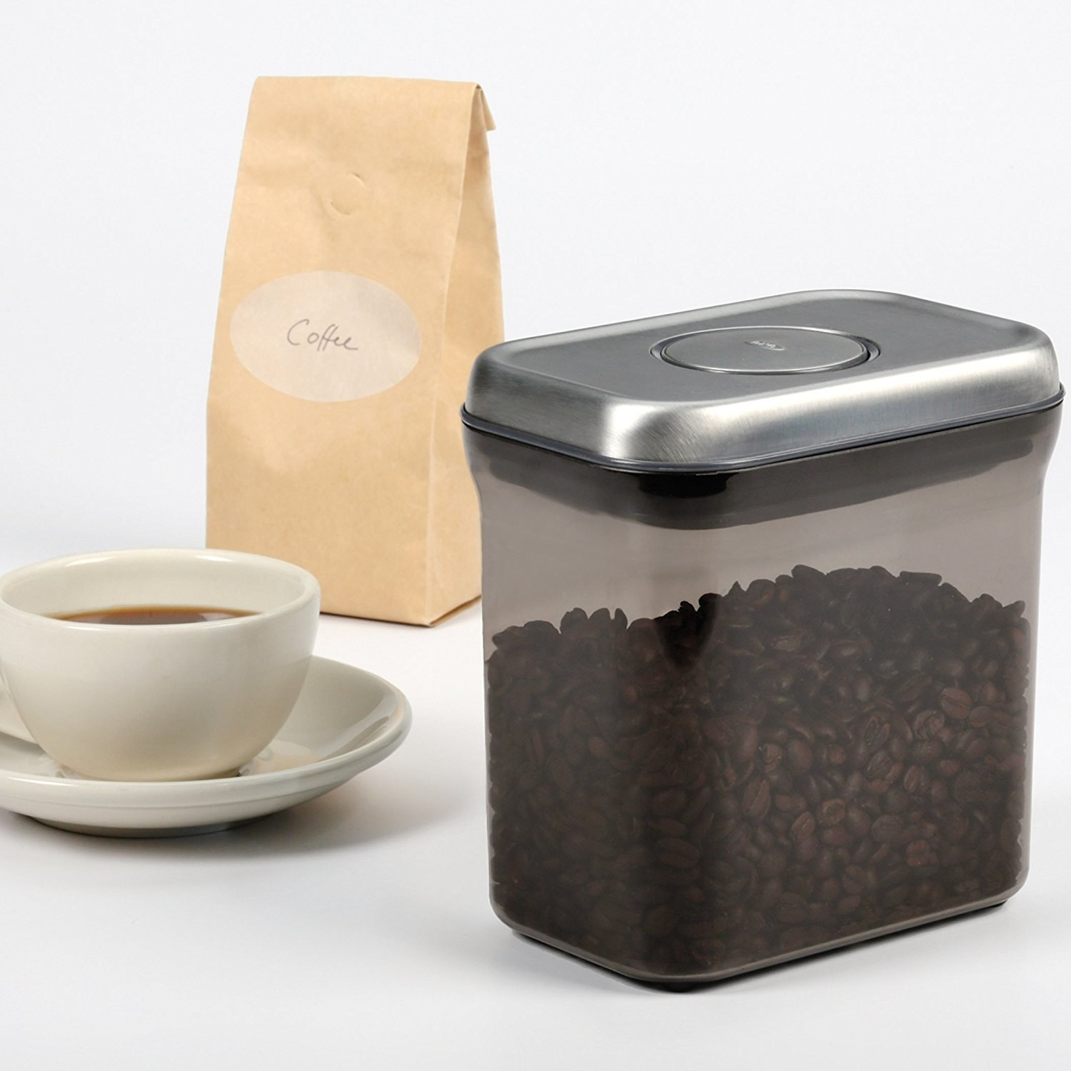 coffee beans in a dark tinted container with a sealing button on top that helps with freshness.