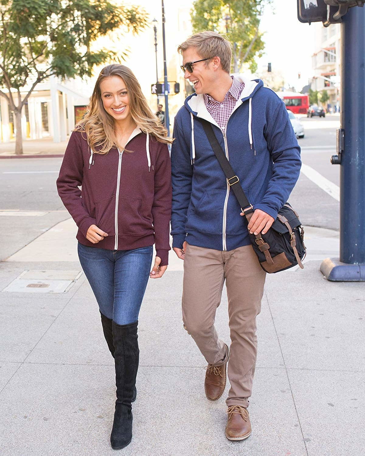 Two models in the sweatshirt: one in burgundy and one in blue