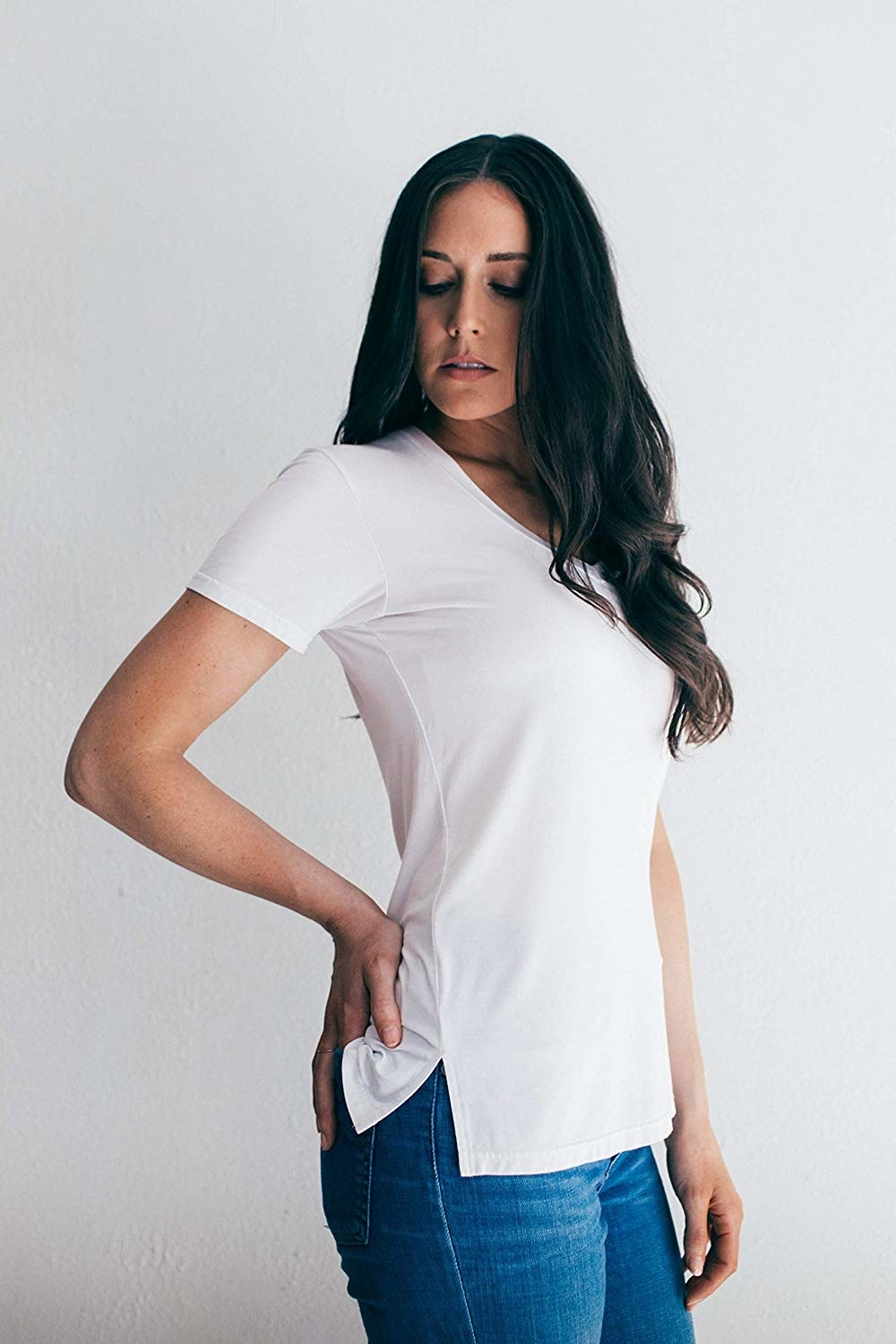 A model in the white tee with small vents on the sides