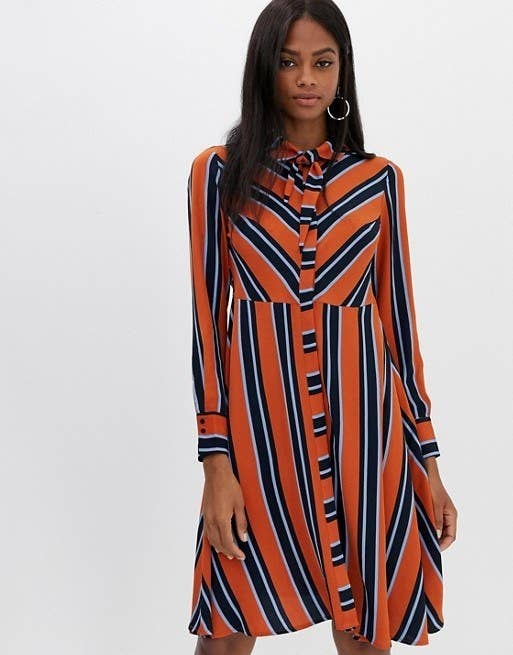 43b4c0eb155e88 1. A stunning striped shirtdress with a comfortable silhouette and colors  that stand out above the rest. That built-in neck tie is doing all the work  so you ...