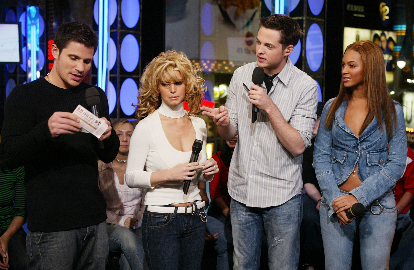 With failed couple, Nick Lachey and Jessica Simpson.