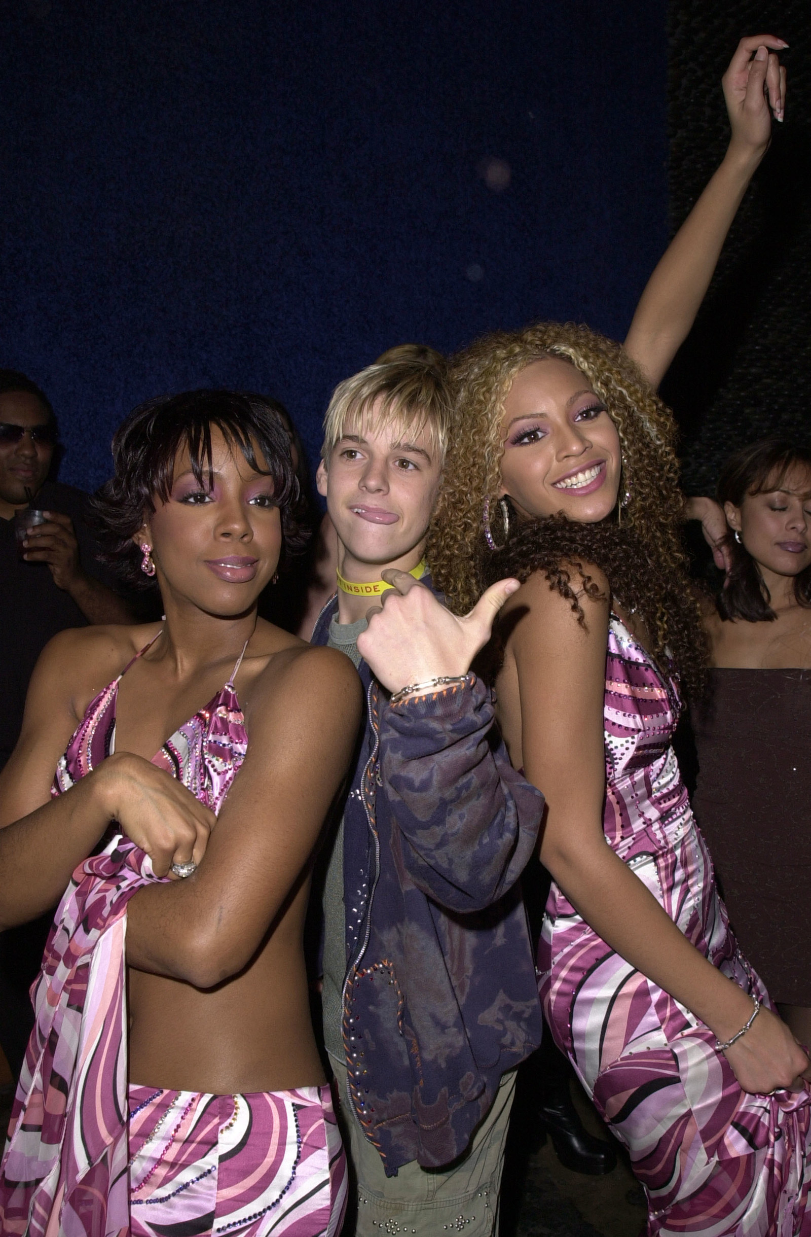 First of all, this picture where she's losing her shit grinding with Kelly Rowland and Aaron Carter.