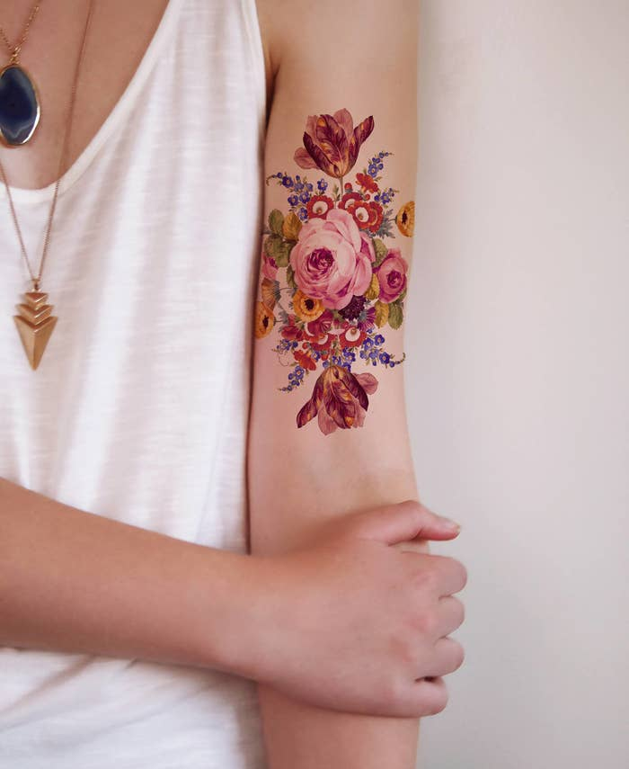 d76b06e3e4b87 A floral tapestry for anyone who loves flowers so much they'd rather have  them on their arms than in a vase.