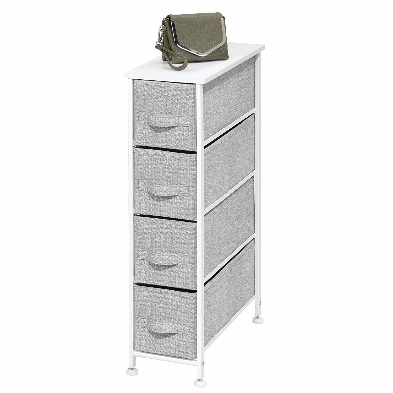 "Promising review: ""This is a great way to reduce clutter! It's a perfect storage solution for me. I put mine in bedroom between my bed and wall. I put it together in a flash, and the fabric bins are very nice. I love the neutral colors available. Plus, you can store a lot of stuff in a very small space!"" —RaySing4CarrotsGet it from Amazon for $49.99 (available in four colors)."
