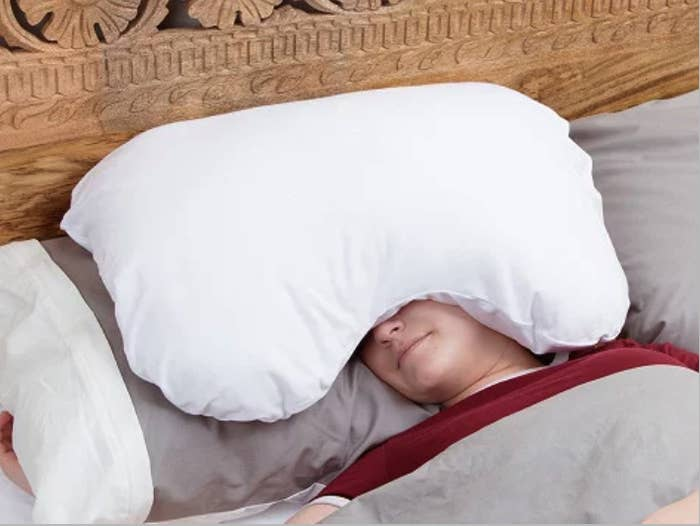 69a2cec6173 An  over -the-head relaxation pillow filled with a lightweight plush and a  curved design to block out light and sound. Want to scream into a pillow  when ...