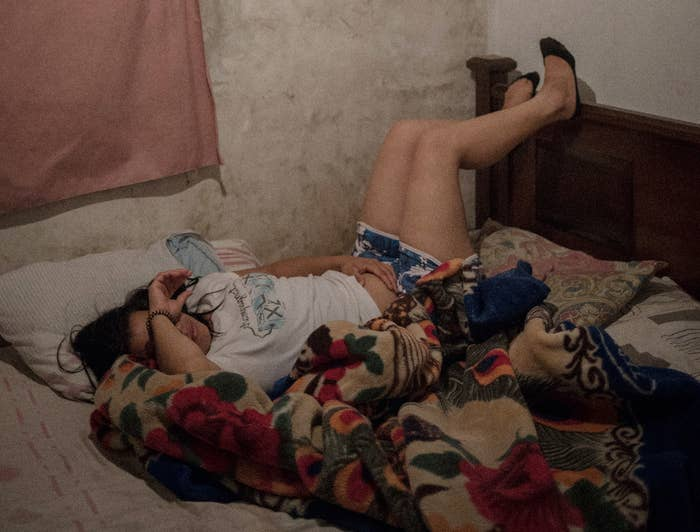 A woman lies in bed during an abortion.