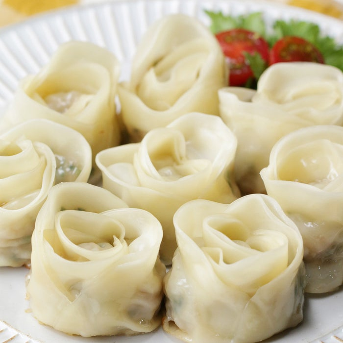 Servings8 dumplingsINGREDIENTS32 sheets dumpling wrappers Filling100 grams (3.5 ounces) shrimp100 grams (3.5 ounces) ground pork25 grams (1 ounce) Chinese chives, minced2 teaspoons sake1 teaspoon sugarPinch of salt2 teaspoons soy sauce1 teaspoon ginger, grated 1 clove grated garlic80 milliliters (⅓ cups) water1 tablespoon sesame oilDumpling Sauce2 tablespoons vinegar2 tablespoons soy sauceChili oilPREPARATIONFor filling, roughly chop the shrimp.Combine ground pork, sake, and salt. Mix them very well in a bowl.Add soy sauce, ginger, and garlic. Mix them very well.Apply water on the right edge of the gyoza skin, then layer on 3 more sheets of gyoza skin.Scoop a spoonful of filling onto the middle of the gyoza skin. Making the flower shape. Fold into half and roll them from left side.Apply water the end of edge and fix.Heat sesame oil in the pan and lay gyoza in a single layer. Keep on medium heat for 2 minutes.When gyoza turns brown, pour in water and put the lid on. Steam for 10 minutes.Take off the lid and pour sesame oil.Cook over low heat for 3 minutes until dumpling wrapper is crispy.Enjoy with gyoza sauce!