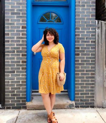 reviewer wears dress in yellow