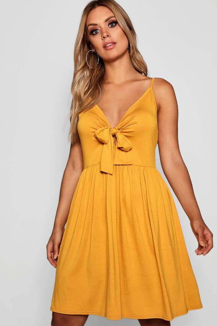 model wears yellow dress with bow front