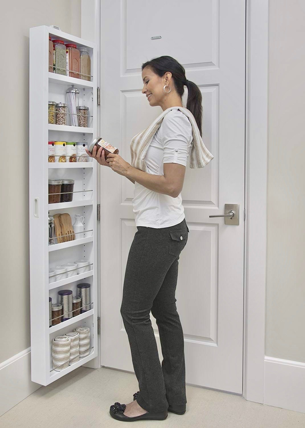 Eight shelf hinged cupboard attached to closed door