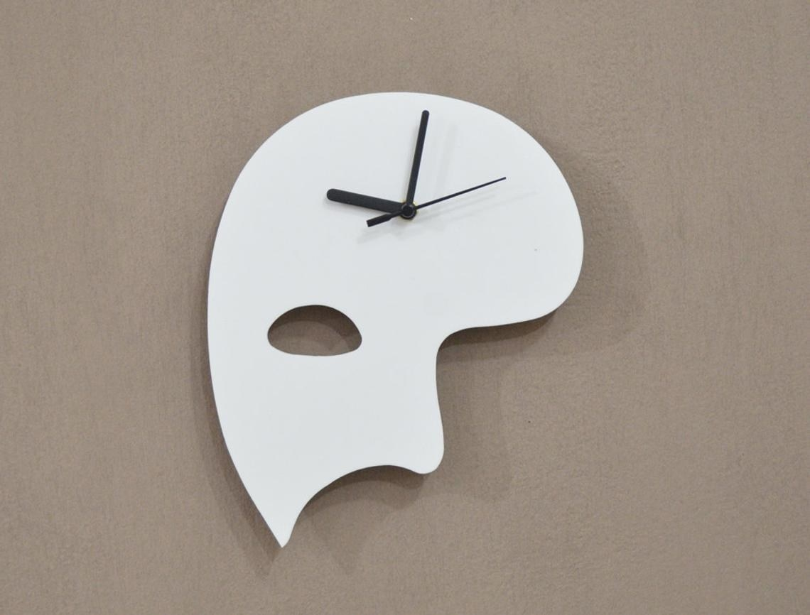 A white phantom half mask with black clock hands