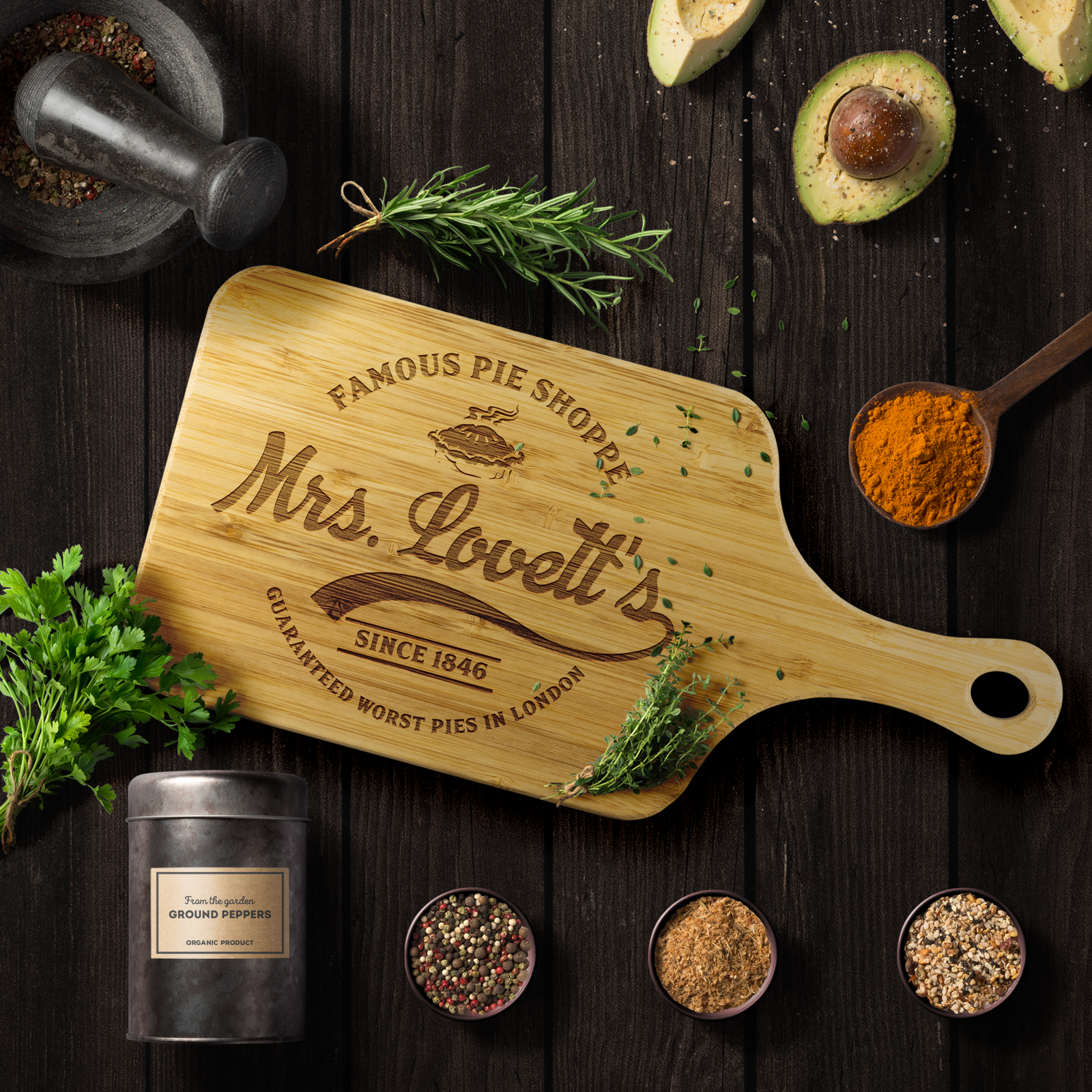 Rectangle wood cutting board with a handle and laser engraved logo for Mrs. Lovett's famous pie shoppe