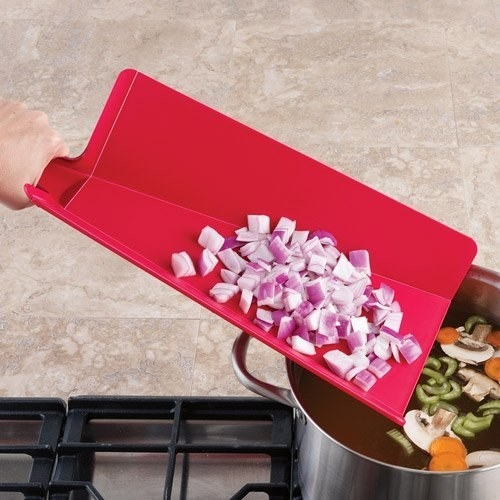 "Promising review: ""This is a great chopping board that folds so you can dump your onions, mushrooms, or whatever from the chopping board to the pan on the stove top with ease. It has rubber grips on the back side so the chopping board doesn't slip easily while chopping. I have this board in three sizes and everyone I know who's worked with them in the kitchen loves them."" —tell it like it isGet it from Amazon for $16.50."