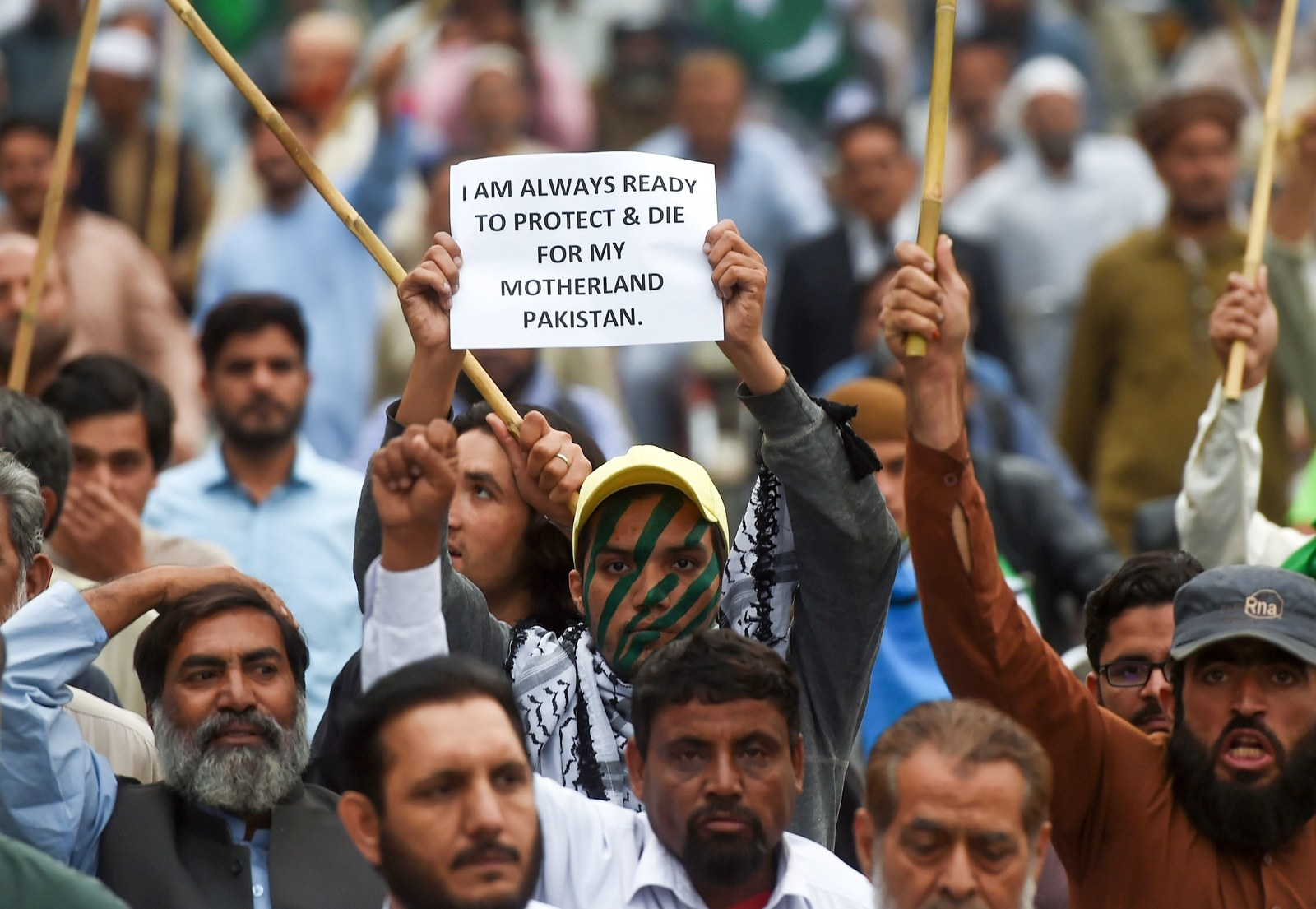 A Pakistani supporter of the Jamaat-e-Islami party holds a placard during an anti-Indian protest rally in Karachi on Feb. 28.