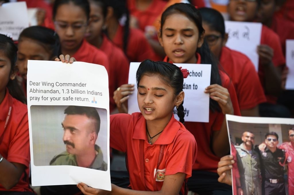 """Indian students pray for a speedy release of Indian Air Force pilot Abhinandan Varthaman in a school in Ahmedabad on Feb. 28. Pakistan said it will release a captured Indian pilot as a """"peace gesture."""""""