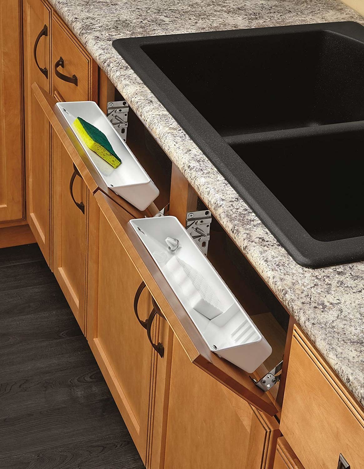 """the """"fake"""" drawers under a sink converted so they tip open to reveal a shallow white caddy that fits sponges"""