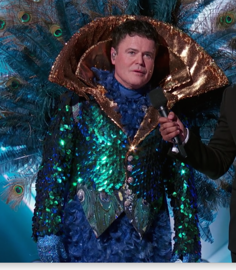 """Donny Osmond was Peacock - Biggest clue revealed:  When he said """"It's probably been a while since your mother had a poster of me on her bedroom wall"""" OR when he said """"I have dedicated my life to show business."""" Also, all of the Las Vegas imagery really nailed it down (in my opinion)."""