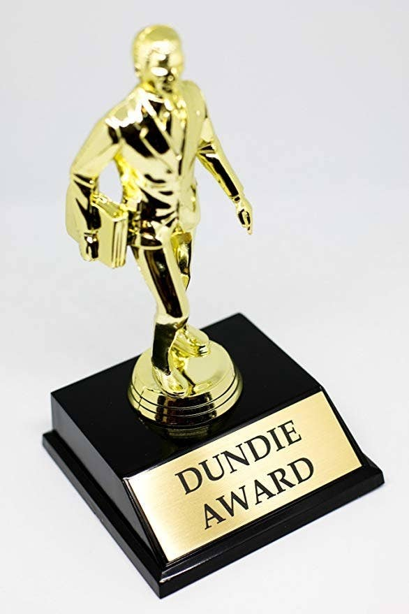 """gold trophy with """"Dundie Award"""" engraved on the bottom"""