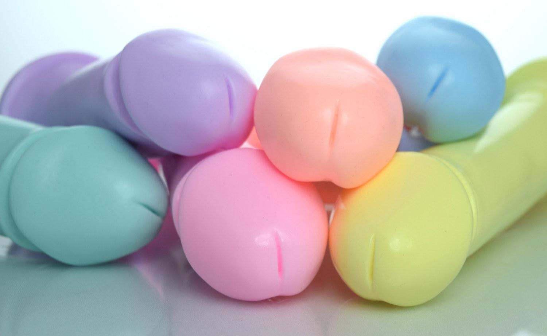 six pastel-colored dildos