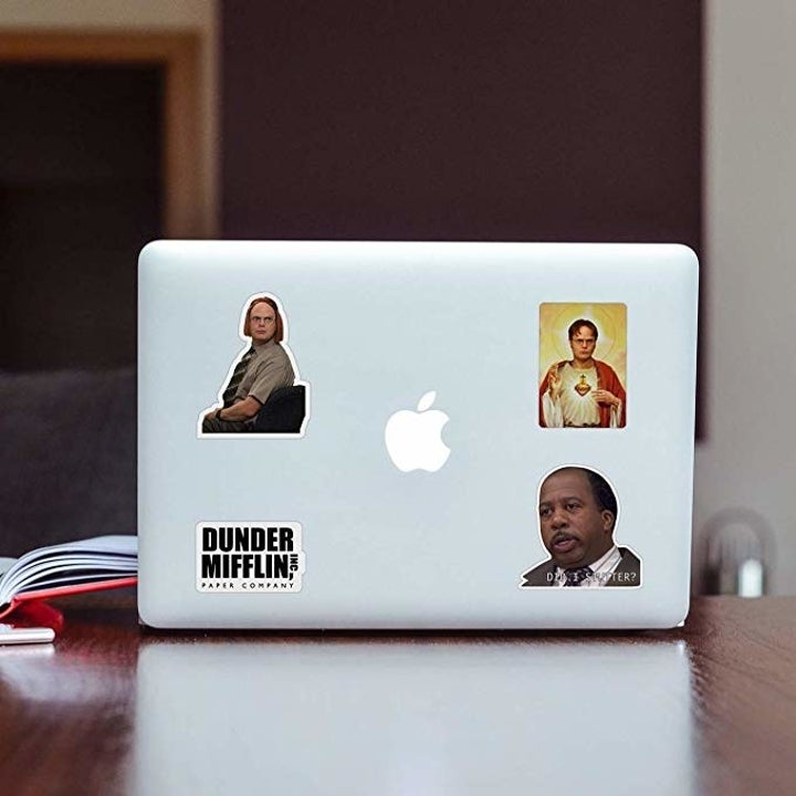 different stickers applied to a laptop