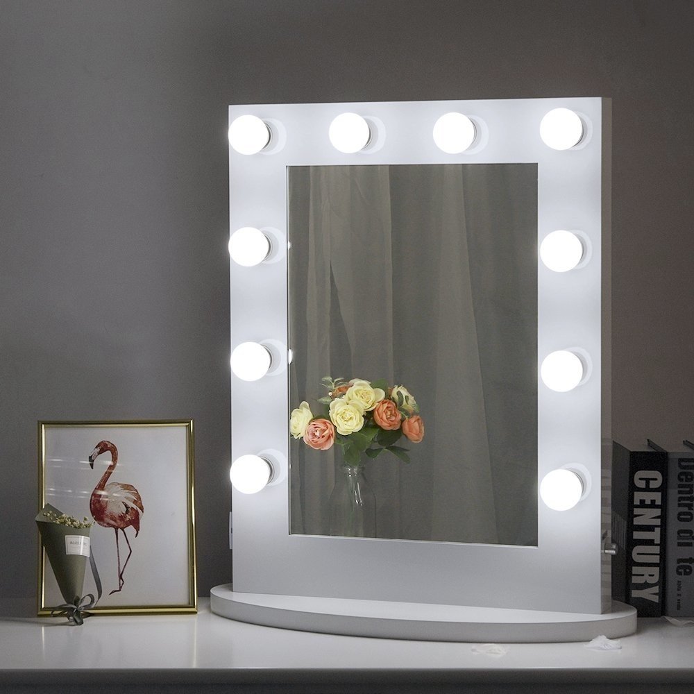 The rectangle mirror with a thick white boarder with LED lights on it
