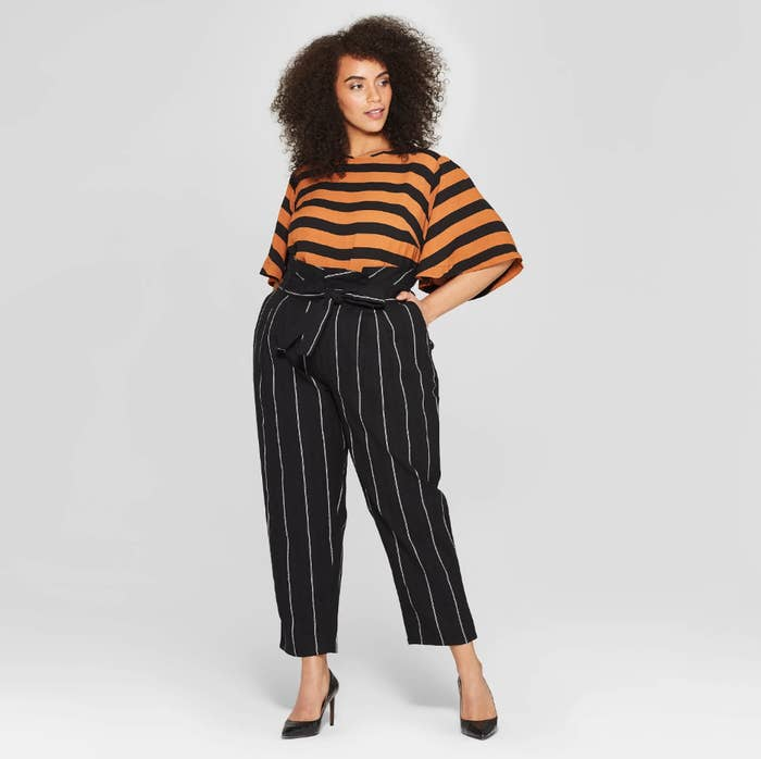 d66e3247207c5f A pair of mid-rise paperbag-waist pants (available in straight and plus  sizes) so stylish and affordable, you'll be on pin(stripe)s and needles  until they ...