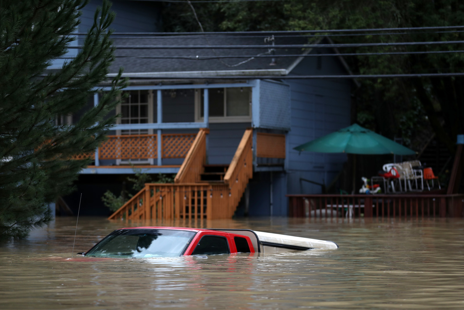 A car sits underwater in a flooded neighborhood on February 27, 2019 in Forestville, California.