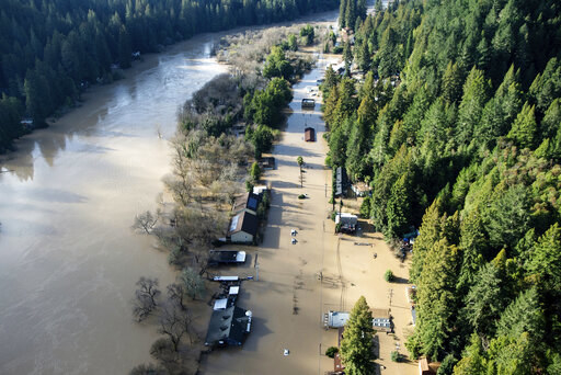 Flood waters from the Russian River partially submerge properties in Guerneville, Calif., on Thursday, Feb. 28, 2019.